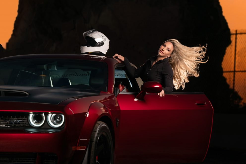 woman with a dodge challenger