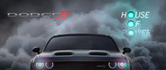 Challenger SRT Hellcat with smoke behind it