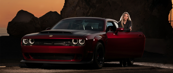 woman with dodge challenger