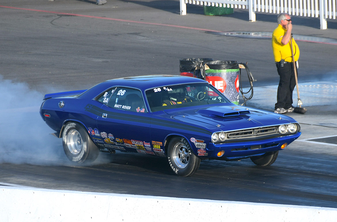 vehicle doing a burnout on the starting line of a drag strip