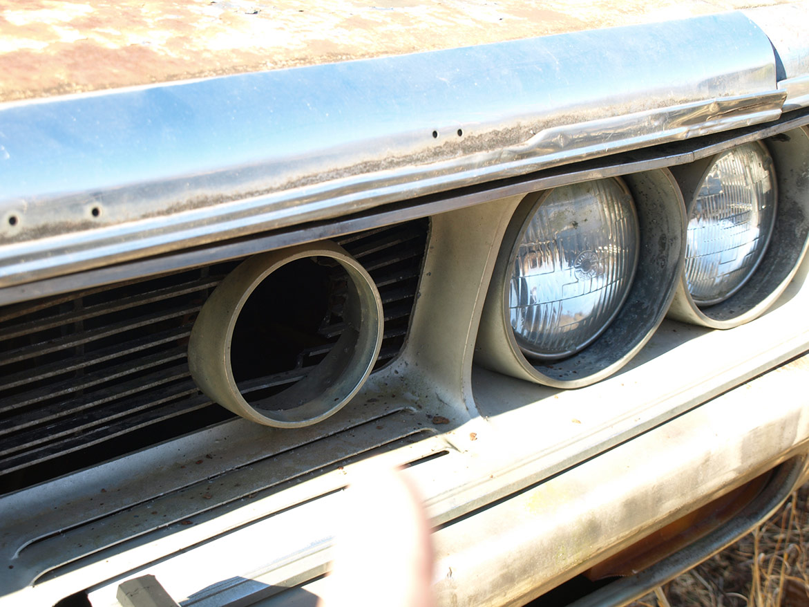 headlights and grill on discarded vehicle