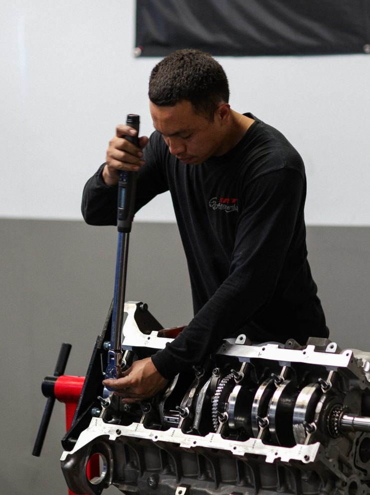 man working on vehicle parts