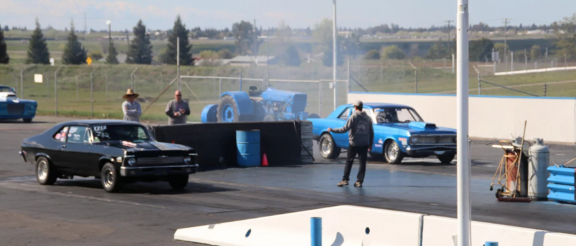 cars on the starting line of a drag strip