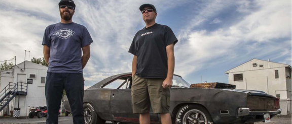 David Freiburger and Michael Finnegan standing with a car