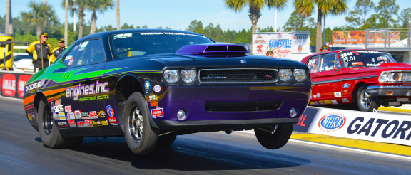 dodge challenger on the starting line of a drag strip