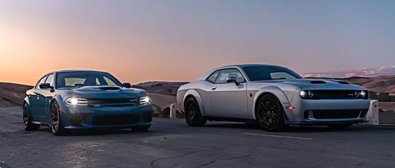 Challenger and Charger driving with sunset in the background
