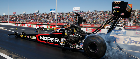 top fuel dragster on the starting line of a drag strip