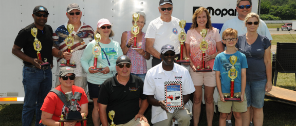group of people holding trophies