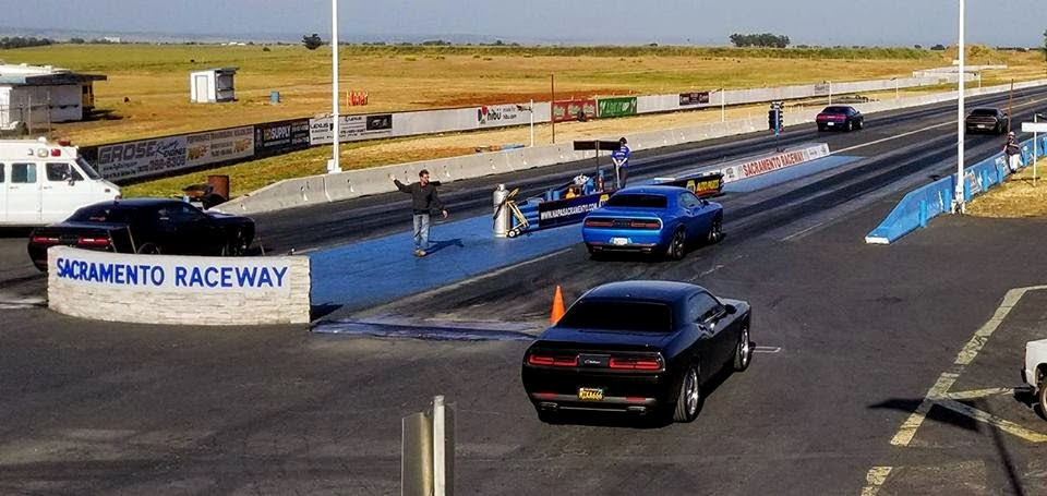 vehicles in the staging lane of a drag strip