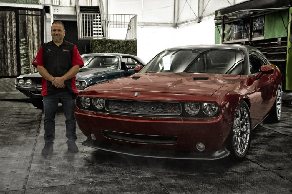 man standing beside his Charger R/T