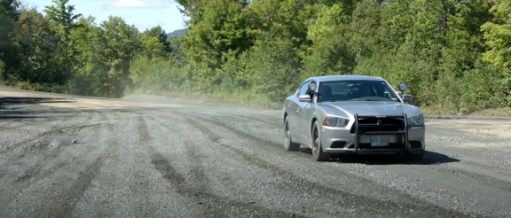 2013 dodge charger police pursuit on a gravel road