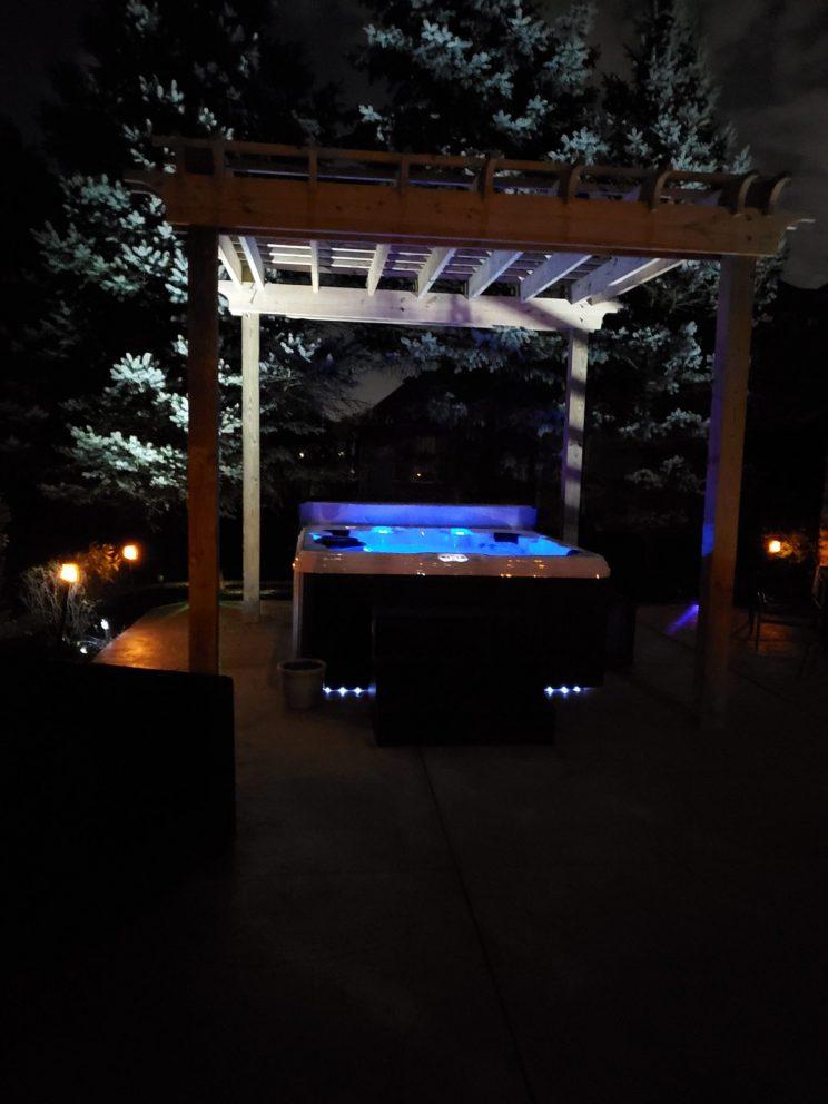 homemade pergola over a hot tub