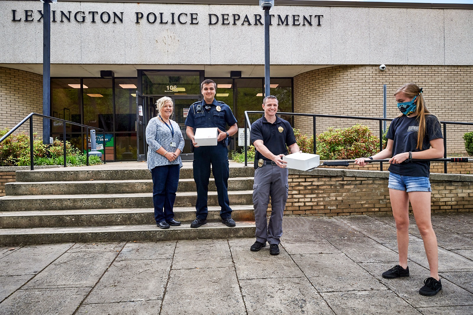 Gray Ledbetter delivering donuts to Lexington Police Department