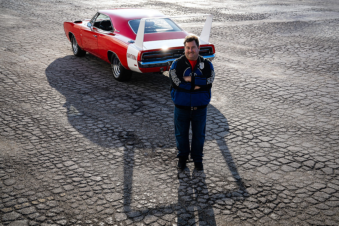 man standing with a vehicle