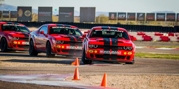 Chargers and Challengers driving on Bondurant track