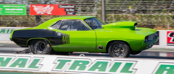 1972 plymouth barracuda on the starting line of a drag strip