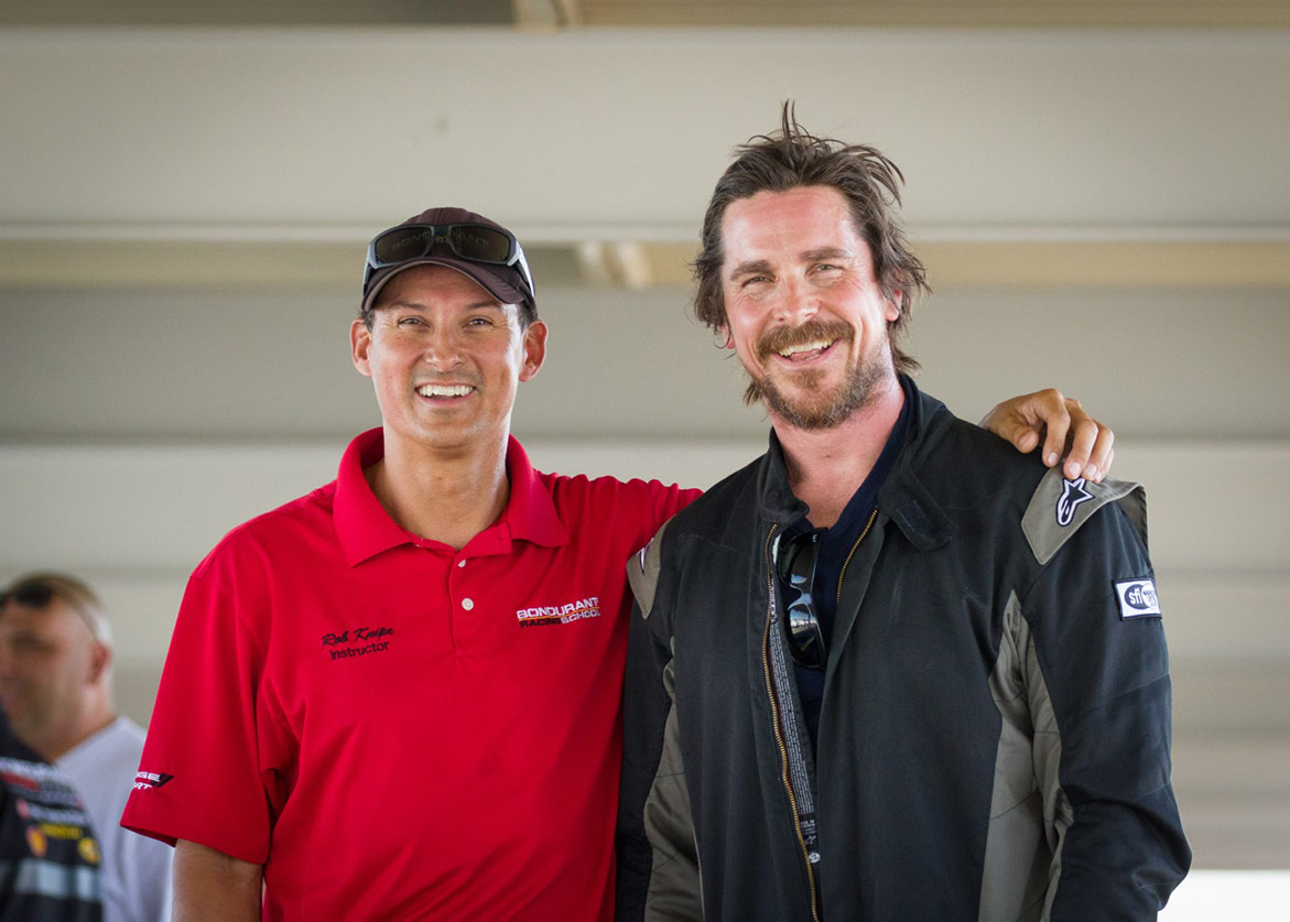 man standing with Christian Bale