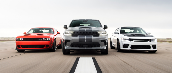 Dodge vehicles on a road