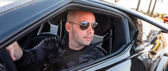 Dave Salvaggio driving a car