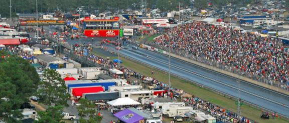 filled grandstands at a drag strip