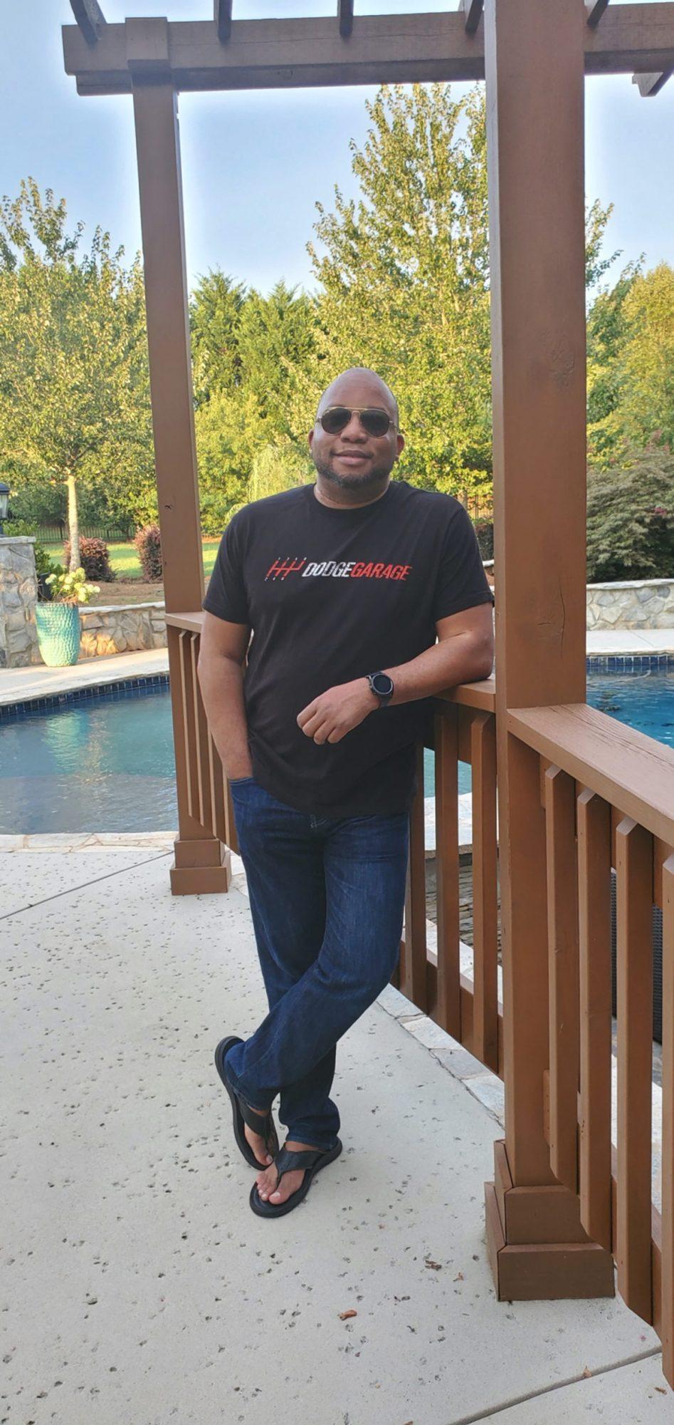 man wearing a DodgeGarage t-shirt