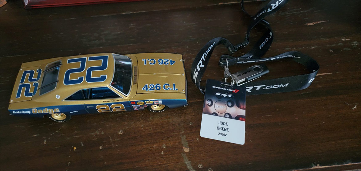 model car and a badge attached to a lanyard