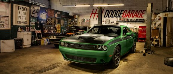 Green Challenger inside of a garage