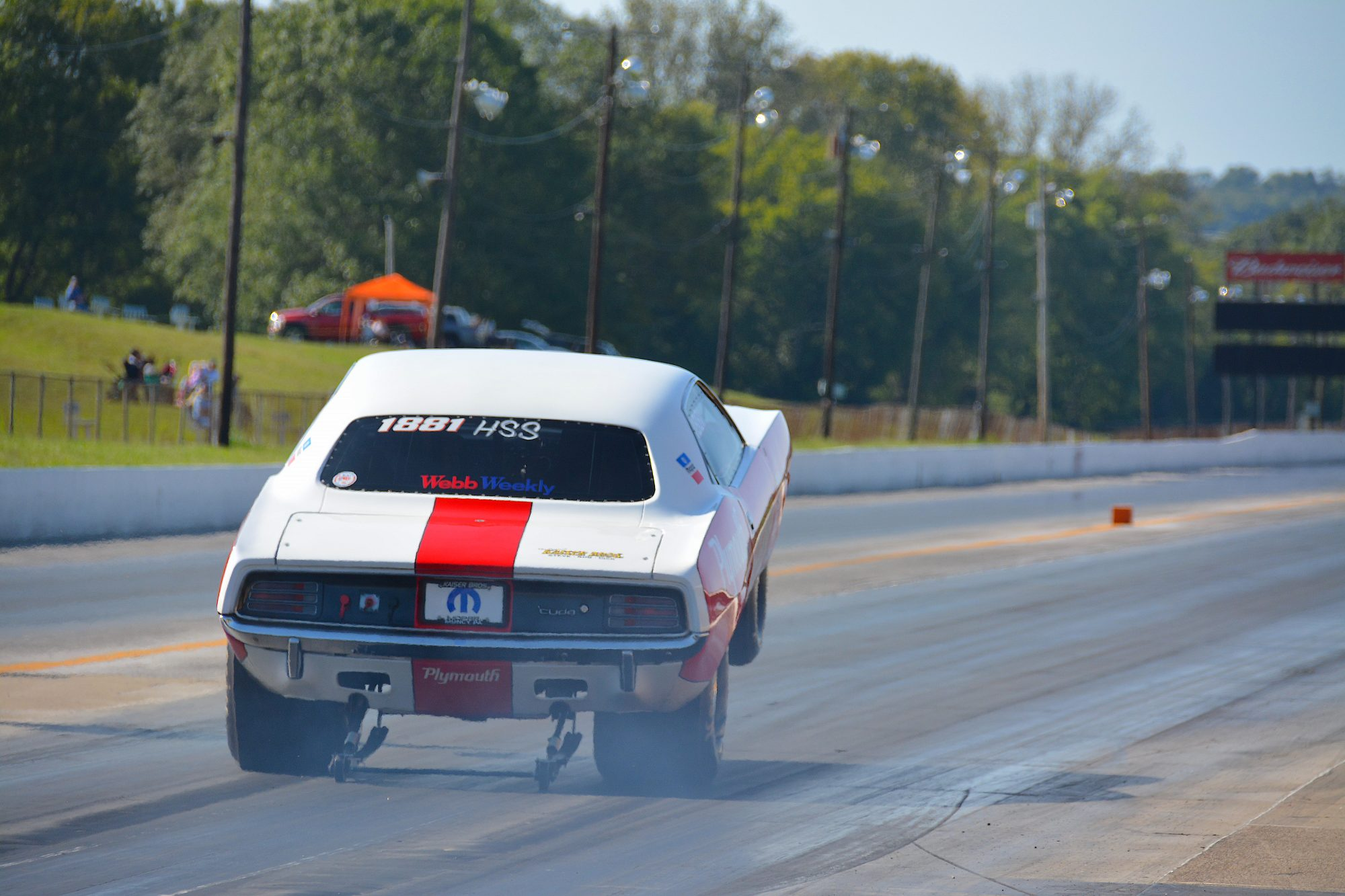 Dodge pulling a wheelie down the track