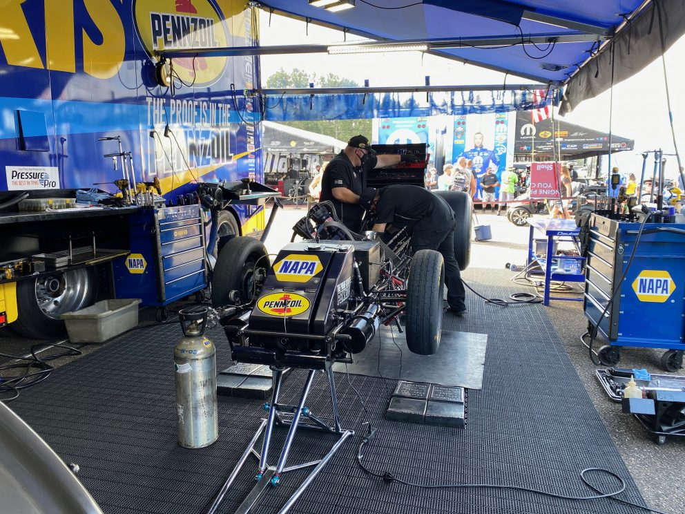 crew working on top fuel car