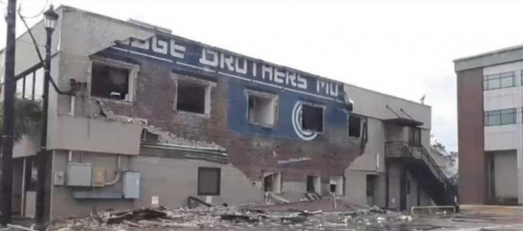 Painted signage on destroyed building