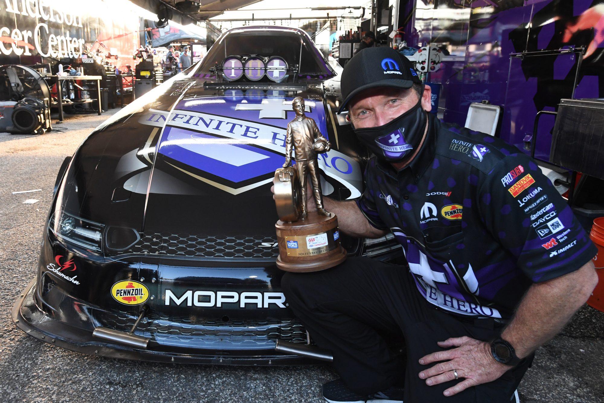 Jack Beckman holding his trophy