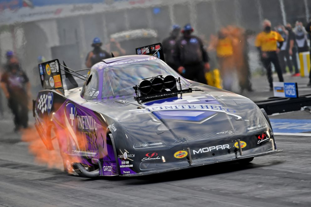 Jack Beckman racing his funny car down the track
