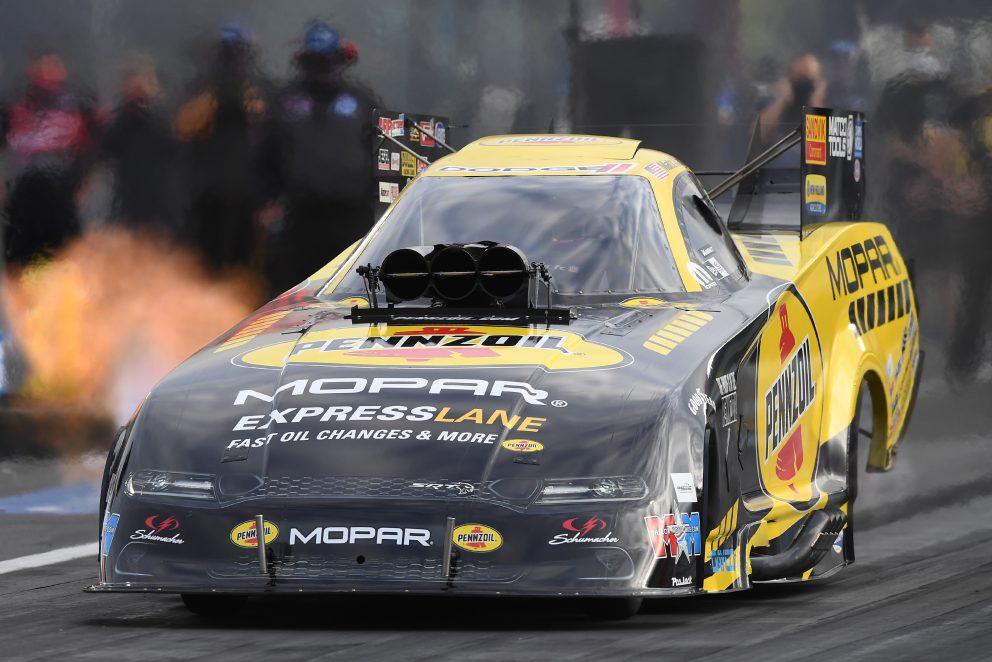 Matt Hagan racing his funny car down the track