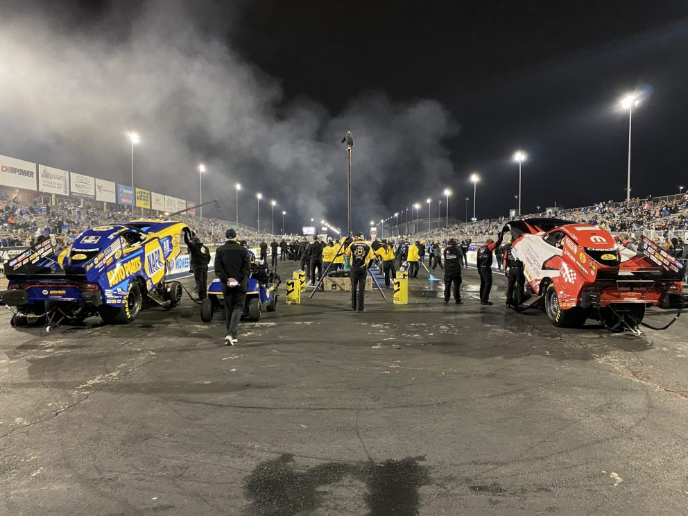 funny cars lined up at the start line