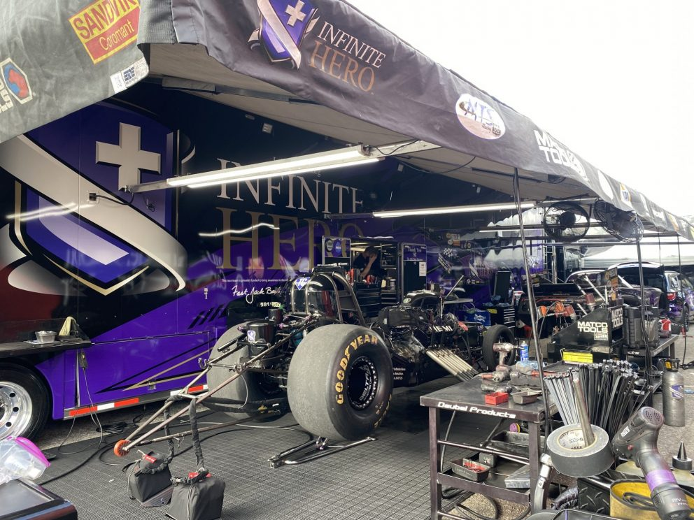 DSR crews working on Jack Beckman's funny car