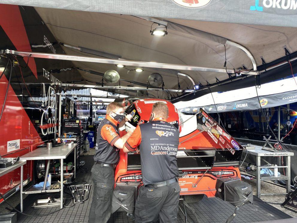 DSR crews working on a funny car
