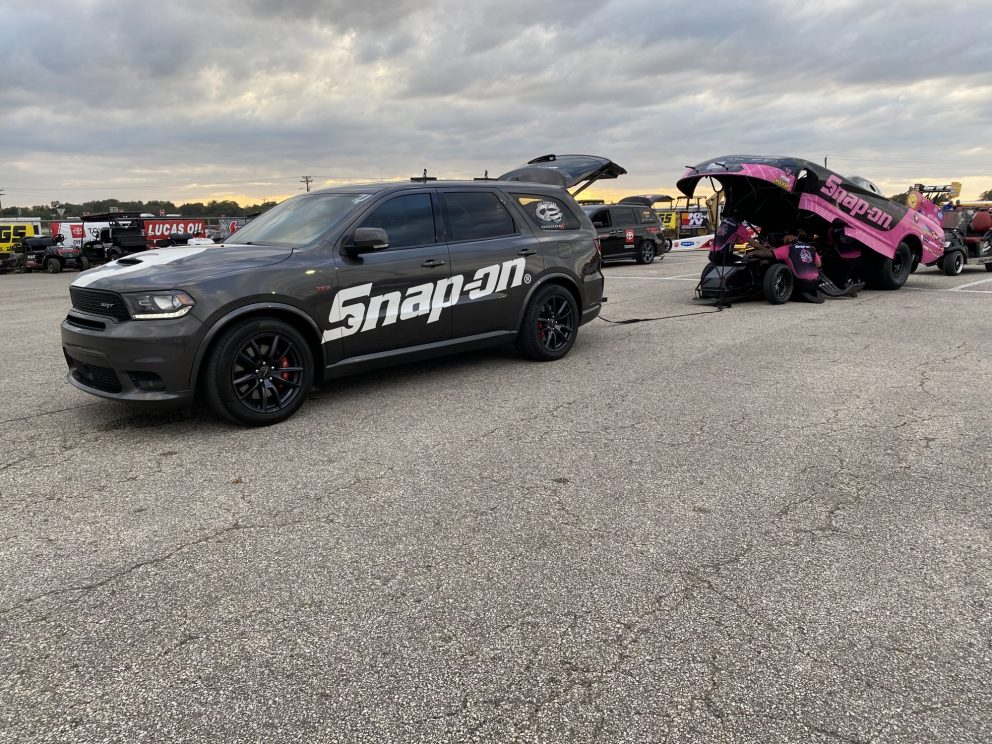 Funny car being pulled to the track by a Durango SRT