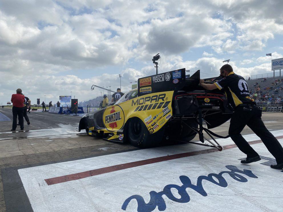 Matt Hagan's team pushing his car to the start line