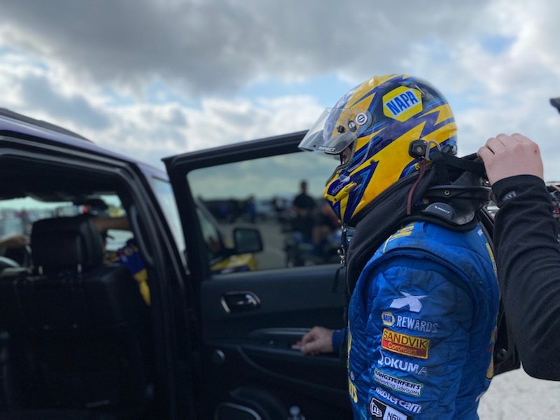 Ron Capps suiting up to race