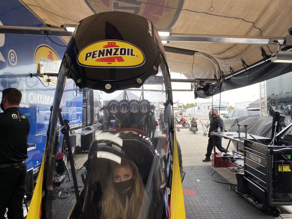 Leah sitting in her top fuel dragster