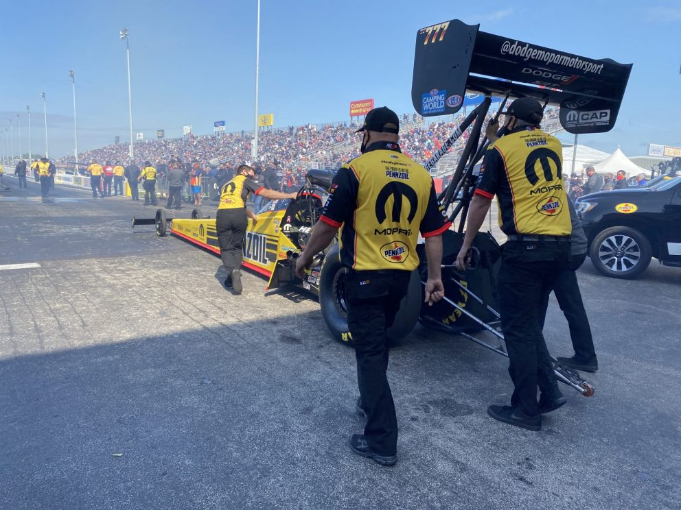 Leah's crew pushing car to the start line