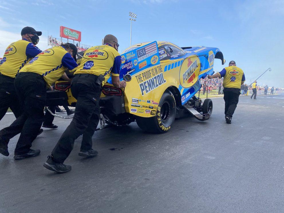 Matt Hagan's crew pushing his funny car to the start line