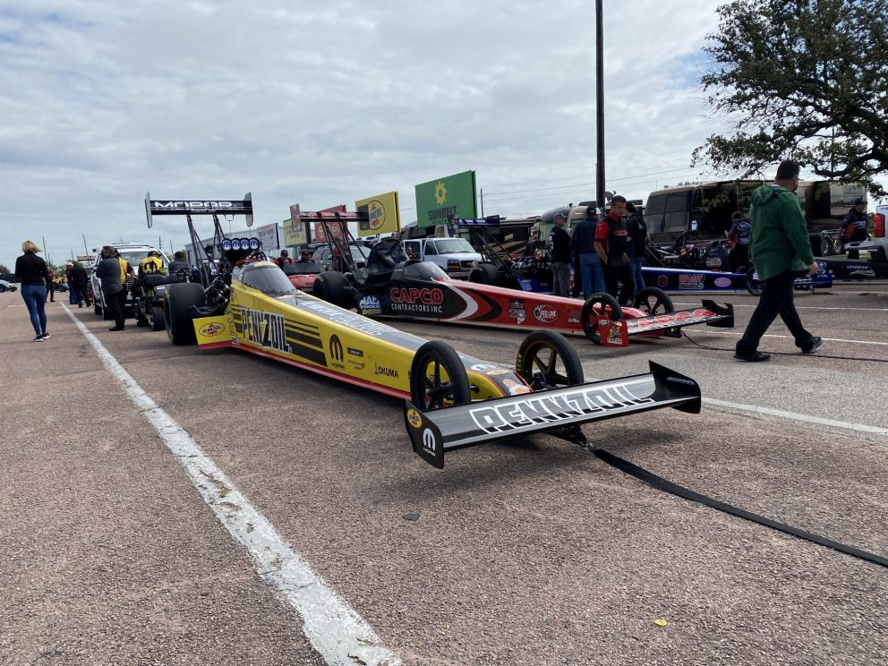 Leah Pruett's top fuel dragster heading to the start line