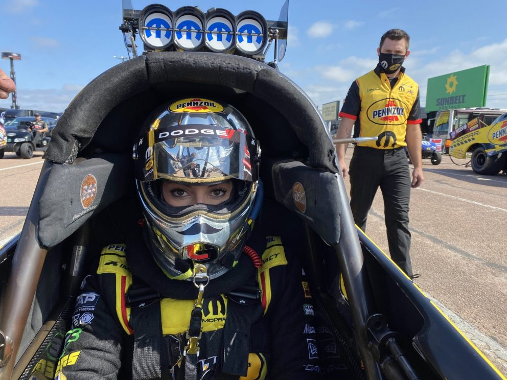 Leah Pruett sitting in her top fuel dragster getting ready to race