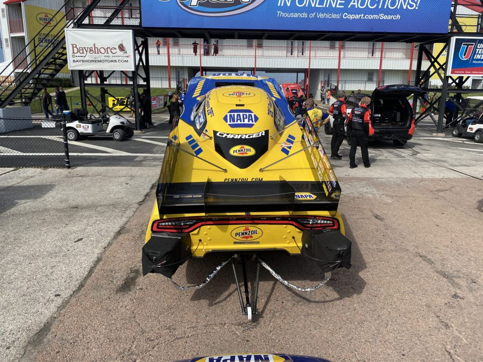 Ron Capps' crew getting his funny car ready to race