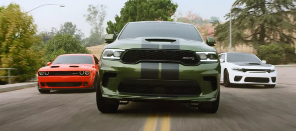 Dodge Charger, Dodge Challenger and Dodge Durango driving on the road