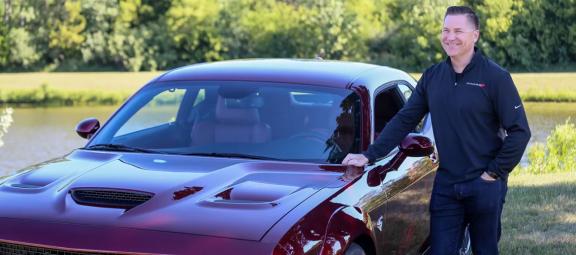 Tim Kuniskis with a Dodge vehicle