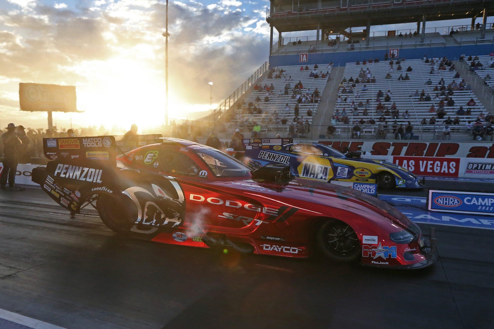Matt Hagan and Ron Capps racing