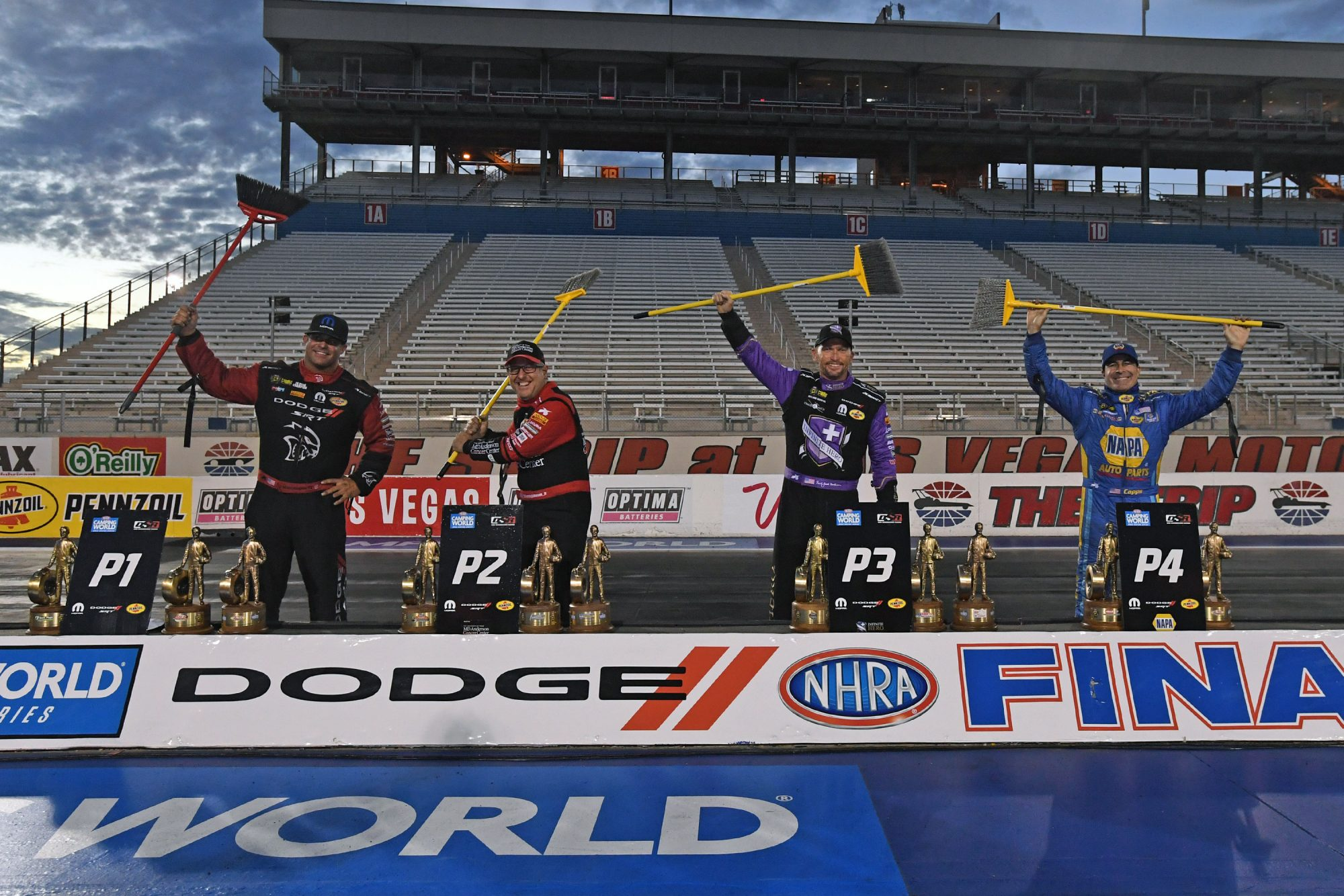 DSR drivers holding brooms representing a season sweep