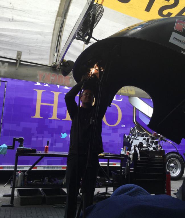 Alex Conaway working on a funny car
